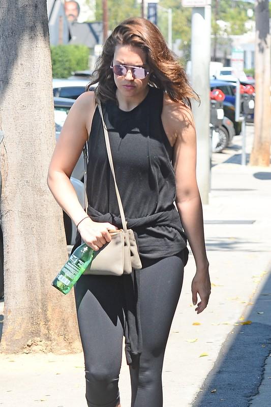 stylish babe Mandy Moore in black capri leggings