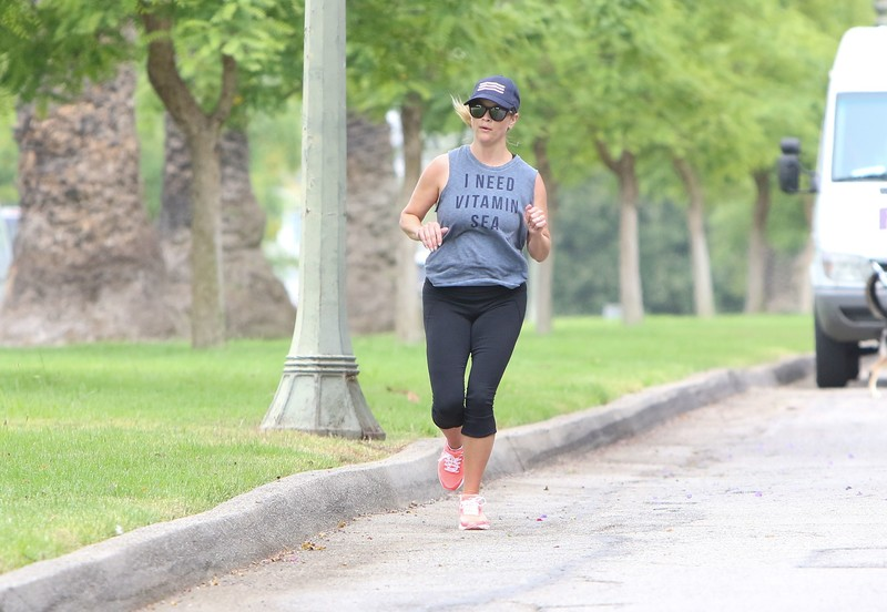 milf jogger Reese Witherspoon in sexy black leggings