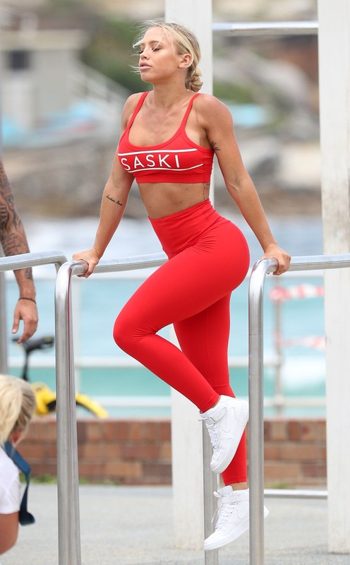 sexy model Tammy Hembrow in red fitness leggings
