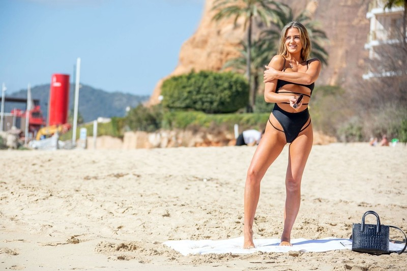 attractive babe Alicia Oates in black 1 piece swimsuit