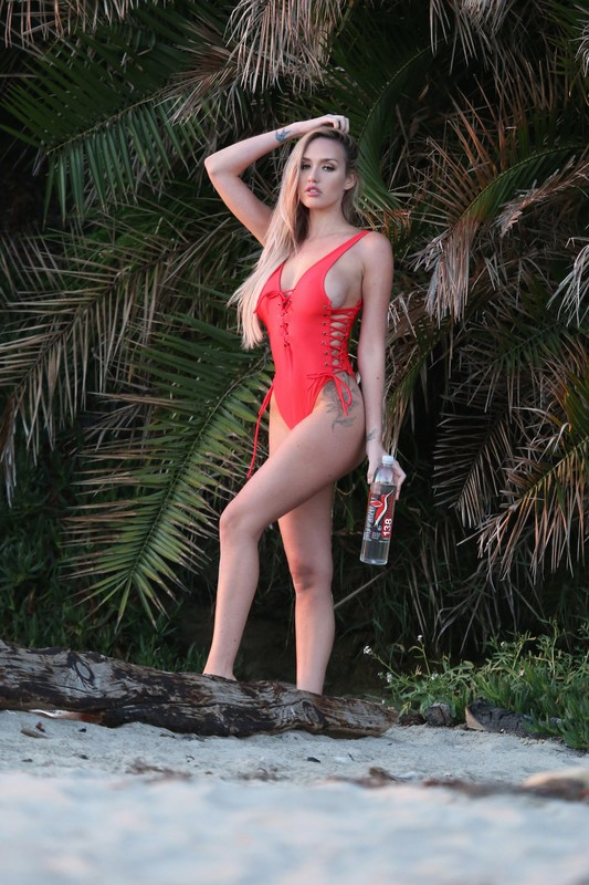 beach girl Jules Liesl in red one piece swimsuit