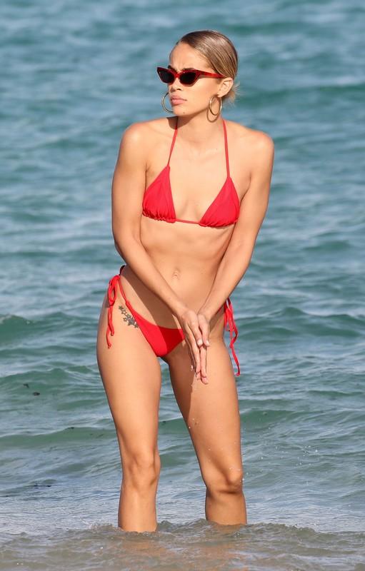 sexy babe Jasmine Sanders in red string bikini