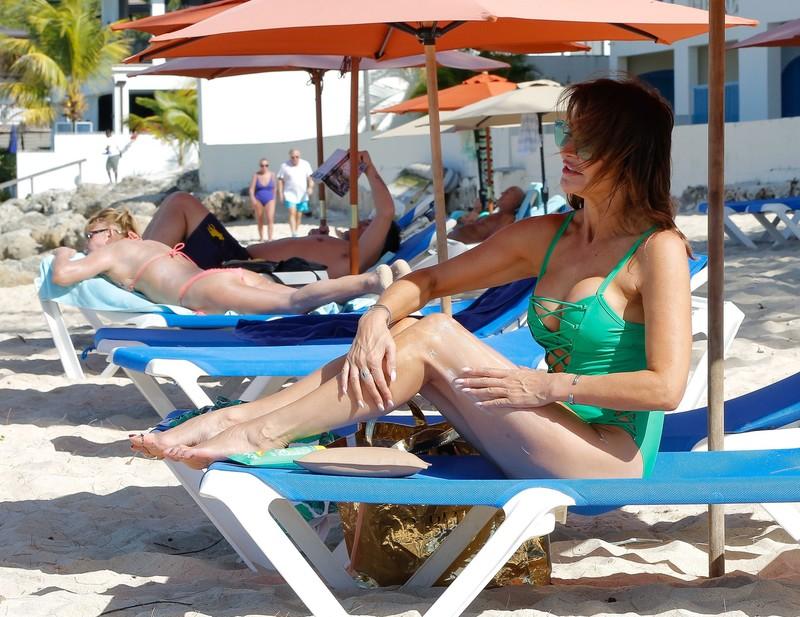 milf Lizzie Cundy in green 1 piece swimsuit
