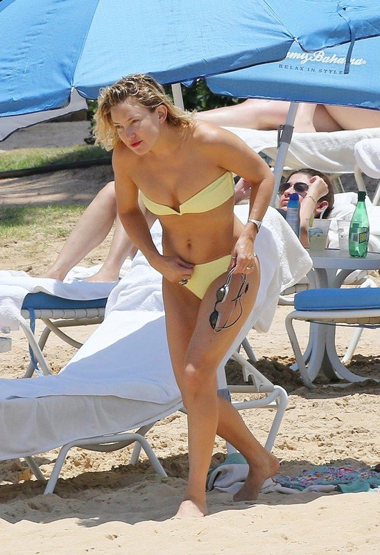 sexually attractive lady Kate Hudson in yellow strapless bikini