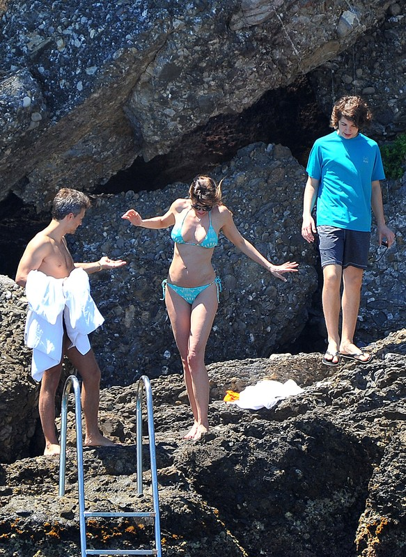 charming babe Luciana Gimenez in wet blue bikini