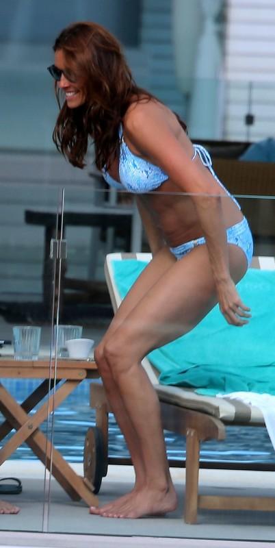 hot babe Melanie Sykes in blue bathing suit