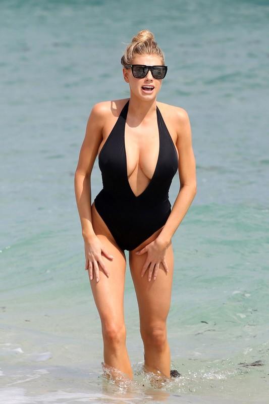 busty lady Charlotte McKinney in black 1 piece swimsuit