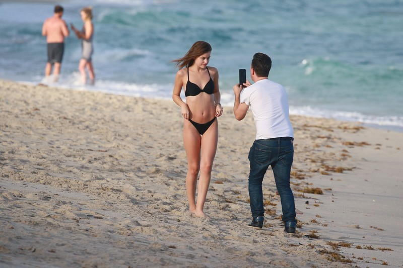 cheerful teen Lexi Wood in black bikini