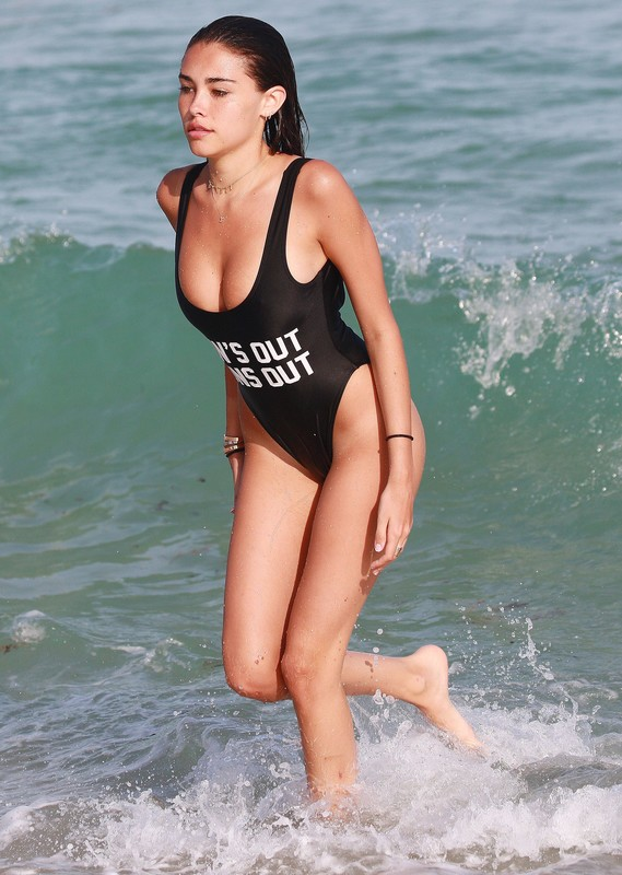 attractive babe Madison Beer in wet black 1 piece swimsuit