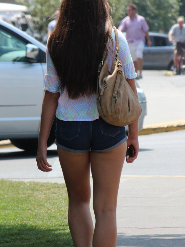 stylish college babe in jean shorts