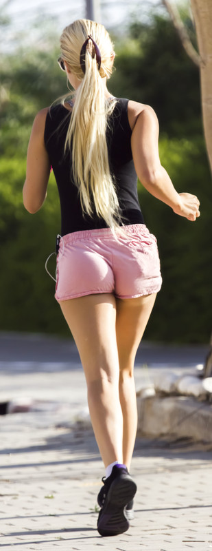 blonde jogger girl in pink shorts