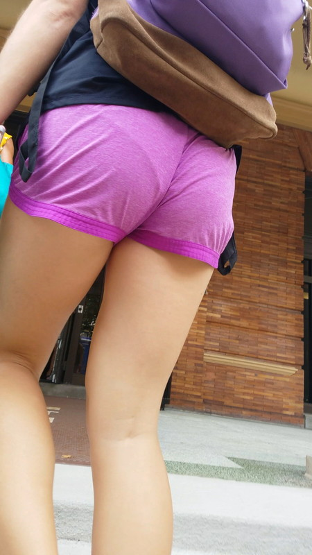 college booty in candid purple fitness shorts