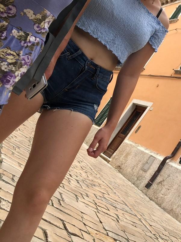 college girl in supertight denim shorts & a short top