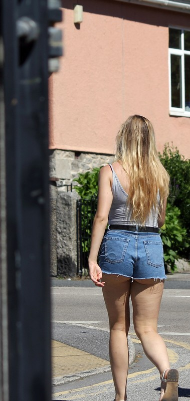 blonde college lady in denim shorts