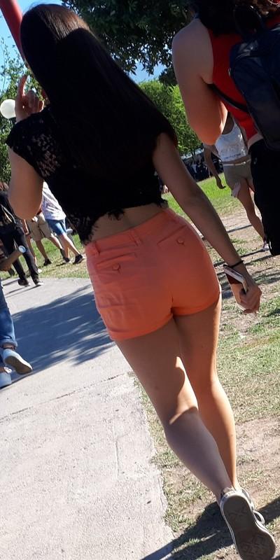 coed latina booty in tight orange shorts