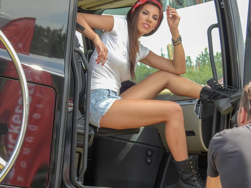 car show model in denim shorts